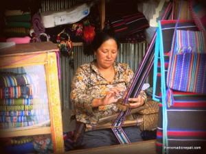 Photo: Local woman busy with handicrafts